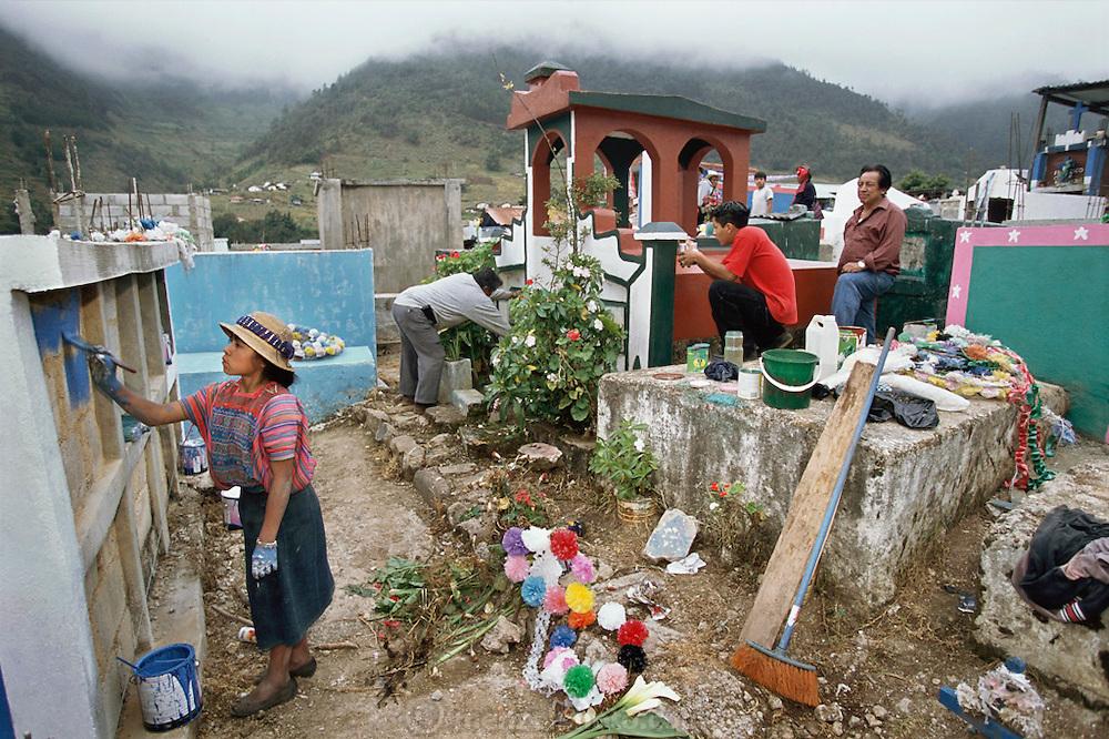 Preparing graveyard for Day of the Dead. Todos Santo de Cuchumatan, Guatemala.