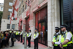London, UK. 27th August, 2021. Metropolitan Police officers stand in front of the Guildhall after blood-red paint was sprayed on its North Wing by environmental activists from Extinction Rebellion during a Blood Money March through the City of London on the fifth day of Impossible Rebellion protests. Extinction Rebellion were intending to highlight financial institutions funding fossil fuel projects, especially in the Global South, as well as law firms and institutions which facilitate them, whilst calling on the UK government to cease all new fossil fuel investment with immediate effect.