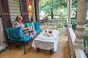 A good southern novel and a glass of sweet tea is a good way to pass the day while relaxing on the front porch and waving to neighbors. PHOTO BY: JEFF JANOWSKI PHOTOGRAPHY