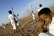 Bedouin boys plays volleyball <br /> <br /> The Sultanate of Oman is a country in Southwest Asia. It borders the United Arab Emirates in the northwest, Saudi Arabia in the west, and Yemen in the southwest.<br /> The oil discovery, in the 60's, started to transform this asleep country. Today, Oman is  torn by modern roads, industrialized and rich ( Omanization ). The tradition still dominates life of the 2,5 million inhabitants: strong religion ( muslim ), traces of tribal loyalties and a very characteristic culture.