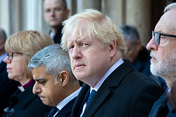© Licensed to London News Pictures. 02/12/2019. London, UK. Prime Minister Boris Johnson (C) stands alongside Labour. Party Leader Jeremy Corbyn (R), Mayor of London Sadiq Khan (2-L) and Bishop of London Sarah Mullally at a vigil at Guildhall Yard following a terrorist attack on London Bridge in which two people were killed. The attacker was shot by police firearms officers and pronounced dead at the scene. Photo credit: Rob Pinney/LNP