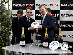 Trainer Aidan O'Brien (Left) receives the winning trainers trophy trophy after his horse Saxon Warrior wins the Racing Post Trophy Stakes during Racing Post Trophy day at Doncaster Racecourse. PRESS ASSOCIATION Photo. Picture date: Saturday October 28, 2017. See PA story RACING Doncaster. Photo credit should read: Clint Hughes/PA Wire