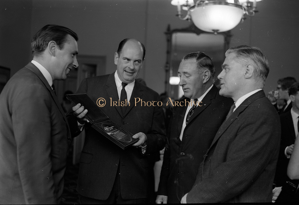 13/07/1967<br /> 07/13/1967<br /> 13 July 1967<br /> International TV award for Kenny's  Advertising Agency Ltd. presented at the Shelbourne Hotel, Dublin. At a reception in the Shelbourne Mr. James Van Buren, of Time Life International, presented the International Market Advertising award, won against competition from 15 countries, to Mr. Michael B. Kenny and Mr. K.A. Kenny, Joint managing directors of Kenny's Advertising. the award, won by Kenny's for the second successive year, was for a 30-sec. television commercial made for Navan Carpets and shown on RTE. <br /> Picture shows Mr James Van Buren, (2nd left) British advertising director of Life International Edition, who was chairman of the panel of judges for the TV award, presenting the award to Mr. M.B. Kenny (2nd right) and Mr. K.A. Kenny (left) with Mr. Allan Mallinson, managing director of Navan Carpets Ltd. who received a replica of the award from Mr. Michael B. Kenny.