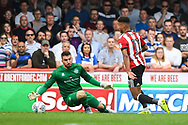 Queens Park Rangers Goalkeeper Matt Ingram (13) fouls and brings down Brentford Forward Ollie Watkins (11) for a penalty during the EFL Sky Bet Championship match between Brentford and Queens Park Rangers at Griffin Park, London, England on 21 April 2018. Picture by Stephen Wright.
