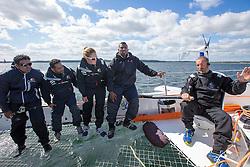 Sami Al Shukaili (OMA), Yassir Al Rahbi (OMA), Mohsin Al Busaidi (OMA) and Anna-Maria Renken (GER) listen to Damian Foxall (IRL) who breeds the crew on the race plan. Oman Sail's MOD70 Musandam during Kiel week 2014, 22-06-2014, Kiel - Germany.