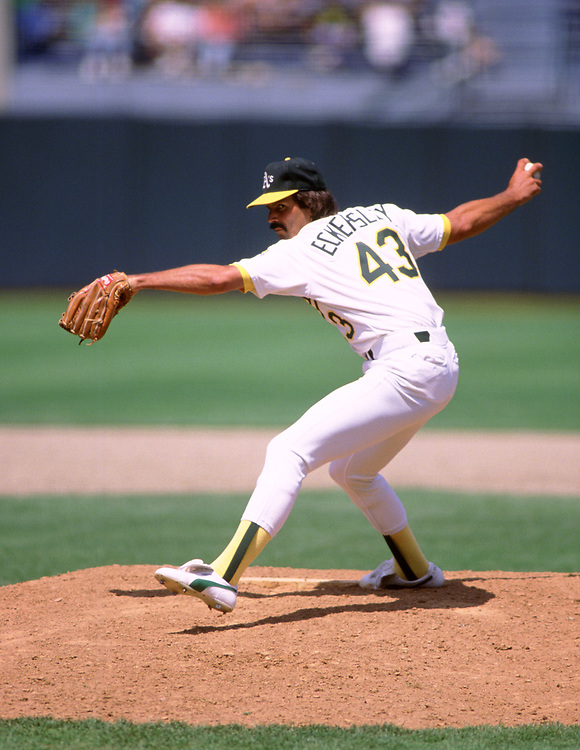 OAKLAND - 1992:  Dennis Eckersley of the Oakland Athletics pitches during a MLB game at The Oakland-Alameda County Coliseum in Oakland, California during the 1992 season. (Photo by Ron Vesely)  Subject:   Dennis Eckersley
