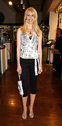Model CLAUDIA SCHIFFER at a party hosted by Elizabeth Saltzman and Harvey Nichols to celebrate the UK launch of New York fashion designer Tory Burch held at the Fifth Floor Restaurant, Harvey Nichols, Knightsbridge, London on 24th May 2006.<br />
