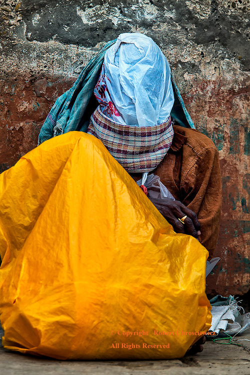 From Suffocation to Salvation:  A Hindu devote, with a fanatical resolve, attempts to find his calling while suffocating  underneath a plastic bag, Varanasi India, Varanasi India.