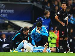 Sergio Aguero of Manchester City lies on the turf with an injury - Mandatory byline: Matt McNulty/JMP - 07966386802 - 12/04/2016 - FOOTBALL - Etihad Stadium -Manchester,England - Manchester City v Paris Saint-Germain - UEFA Champions League - Quarter Final Second Leg