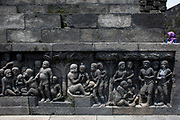 Detailed carving from the Borobudur Temple in Magelang, Central Java, Indonesia. Borobudur is the largest Buddhist temple in the world built in the 9th-Century. Designated a UNESCO World Heritage Site in 1991, Borobudur remains Indonesia's most visited tourist attraction.