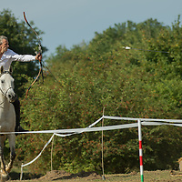 Robin Descamp of France shoots his arrow during  the European Open Championship of Horseback Archery in Veroce, about 60 km (37 miles) north of the capital Budapest, Hungary on August 31, 2012. ATTILA VOLGYI