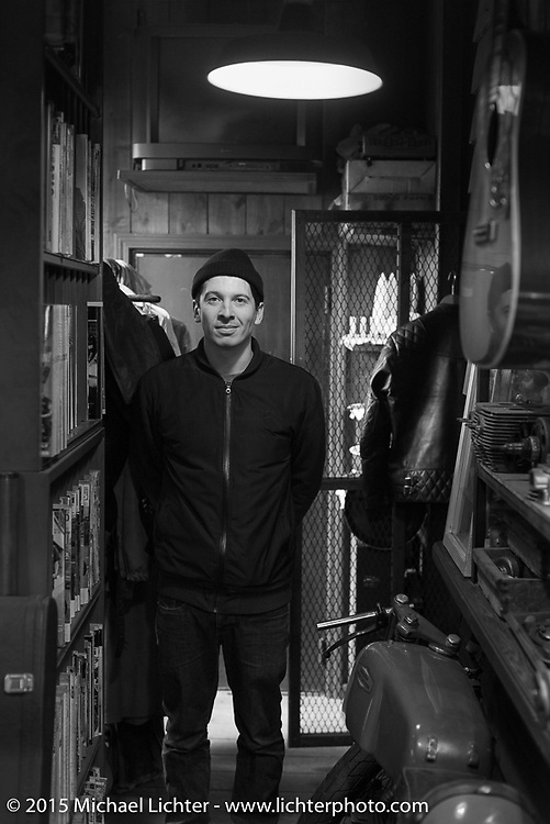 Maximilian Funk of Gestalten Publishing on a visit to Animal Boat custom motorcycle shop after Mooneyes. Tokyo, Japan. December 8, 2015.  Photography ©2015 Michael Lichter.