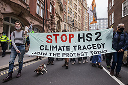 Activists from HS2 Rebellion, an umbrella campaign group comprising longstanding campaigners against the HS2 high-speed rail link as well as Extinction Rebellion activists, march to a protest outside the Department for Transport on 4 September 2020 in London, United Kingdom. Activists glued themselves to the doors and pavement outside the building and sprayed fake blood around the entrance during a protest which coincided with an announcement by HS2 Ltd that construction of the controversial £106bn high-speed rail link will now commence.