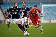 Mark Beevers of Millwall (l) and Federico Macheda of Cardiff City chasing the ball. Skybet football league championship match , Millwall v Cardiff city at the Den in Millwall, London on Saturday 25th October 2014.<br /> pic by John Patrick Fletcher, Andrew Orchard sports photography.