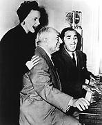 Sam Goldwyn (1882-1974) Polish-born American film magnate, with Judy Garland (1922-1969) American filmstar, and another artist