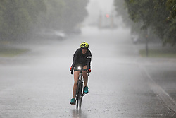 © Licensed to London News Pictures. 07/08/2021. London, UK. A woman cycles during heavy rain in Greenwich Park in South East London. A yellow weather warning for thunderstorms is in place for parts of England. Photo credit: George Cracknell Wright/LNP