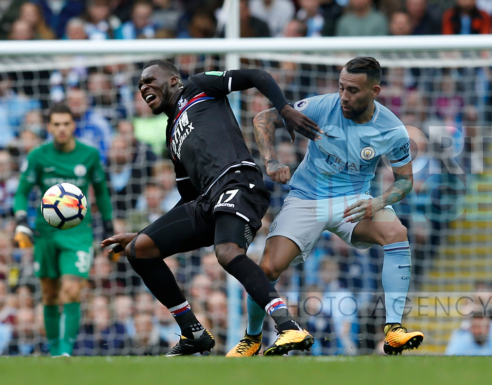 Christian Benteke of Crystal Palace tackled by Nicolas Otamendi of Manchester City during the premier league match at the Etihad Stadium, Manchester. Picture date 22nd September 2017. Picture credit should read: Simon Bellis/Sportimage
