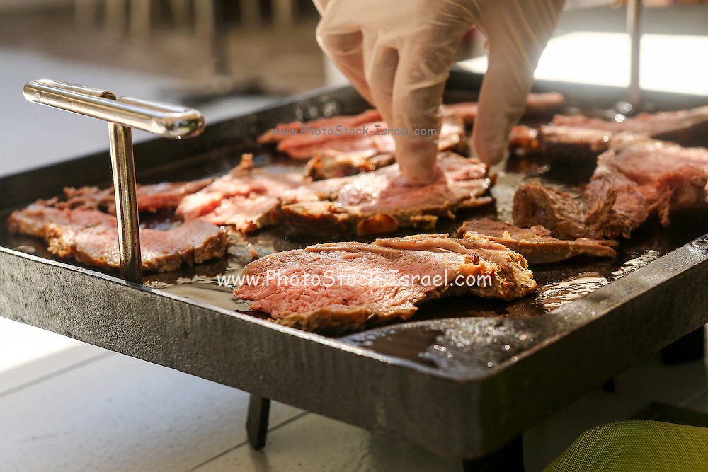 preparing Roast Beef at a buffet table