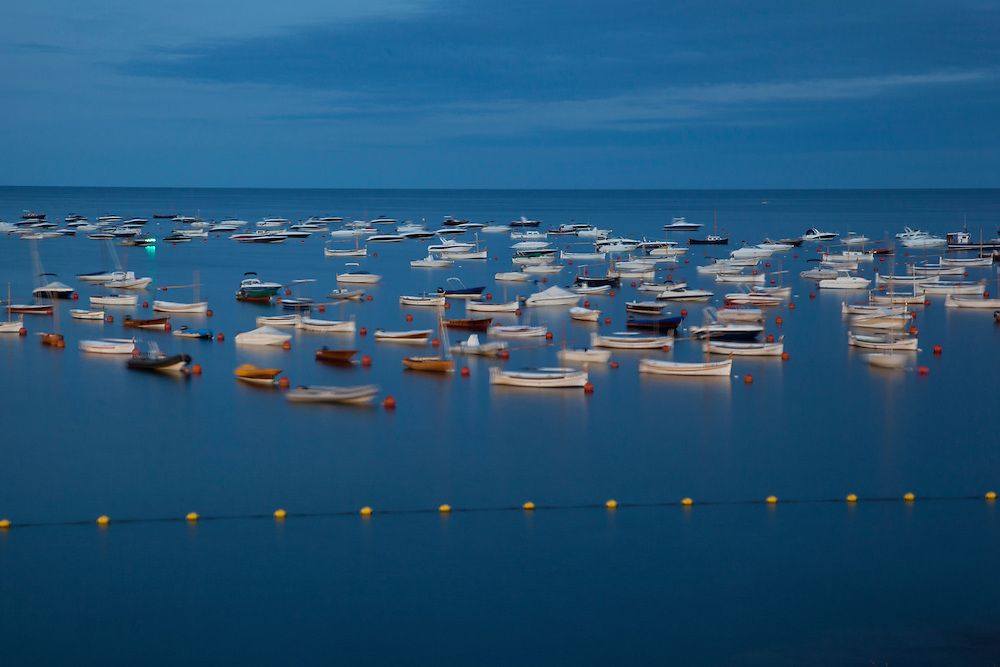 Boats in the Cadaques bay at night, Catalonia, Spain.