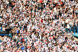 England fans in the stands wave flags during the International Friendly match at Elland Road, Leeds.