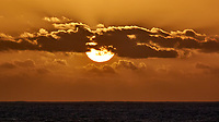 Sun setting over the Pacific Ocean from the deck of the MV World Odyssey. Semester at Sea, 2016 Spring Semester Voyage. Day 3 of 102. Image taken with a Nikon 1 V3 camera and 70-300 mm VR lens (ISO 200, 300 mm, f/8, 1/1000 sec).