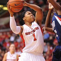 Mar 2, 2009; Piscataway, NJ, USA; Rutgers guard Khadijah Rushdan (1) has a shot blocked by Connecticut center Tina Charles (31) during the first half of Rutgers game against nationally rated #1 Connecticut at the Louis Brown Athletic Center.  Connecticut won 69-59 to finish their regular season a perfect 30-0.