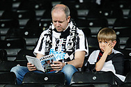 Newcastle United football fans, football supporters during the Premier League match between Fulham and Newcastle United at Craven Cottage, London, England on 12 May 2019.
