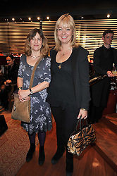 Left to right, CHARLOTTE METCALF and EMMA COOPER-KEY at a party to view jewellery by Adler and paintings by Marie Guerlain held at Adler, 13 New Bond Street, London W1 on 9th February 2011.