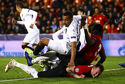 December 12, 2018 - Valencia, Spain - Ruben Vezo of Valencia CF (T) Eric Bailly of Manchester United  (C) and Phil Jones of Manchester United  (B) during UEFA Champions League Group H between Valencia CF and Manchester United at Mestalla stadium  on December 12, 2018. (Photo by Jose Miguel Fernandez/NurPhoto) (Credit Image: © Jose Miguel Fernandez/NurPhoto via ZUMA Press)