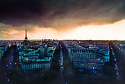 Panoramic view of skyline, taken from the top of the the Arc de Triomphe, with huge grey rain clouds looming over the city,10th May 1980, Paris, France.
