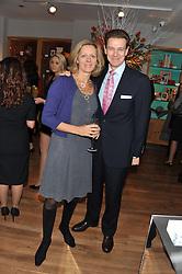 JAMES & JULIA OGILVY at the Linley Christmas party at Linley, 60 Pimlico Road, London on 20th November 2012.