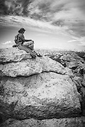 Rock climber on the summit of Tenaya Peak, Tuolumne Meadows, Yosemite National Park, California USA