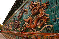 Nine Dragon Screen, Beihai Park - Built in 1756, the Nine Dragon Screen is made of glazed tiles. The screen was made to scare off evil spirits. Apparently it didn't work too well or scare off too many spirits because the temple it once guarded has long disappeared.
