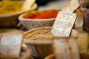 A fresh basket of Garam Masala for sale at an outdoor market in Gordes, France