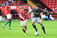 Liam Kinsella of Walsall and Isaiah Brown of Sheffield Wednesday battle for the ball during the EFL Cup match between Walsall and Sheffield Wednesday at the Banks's Stadium, Walsall, England on 5 September 2020.