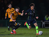 Football - 2018 / 2019 Emirates FA Cup - Fifth Round: Newport County vs. Manchester City<br /> <br /> Manchester City's Leroy Sane holds off the challenge from Newcastle United's Karl Darlow, at Rodney Parade.<br /> <br /> COLORSPORT/ASHLEY WESTERN
