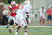 DALLAS, TX - AUGUST 30: Mike Loftus #99 of the SMU Mustangs kicks off against the Texas Tech Red Raiders on August 30, 2013 at Gerald J. Ford Stadium in Dallas, Texas.  (Photo by Cooper Neill/Getty Images) *** Local Caption *** Mike Loftus