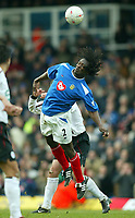 Photo: Scott Heavey.<br /> Portsmouth v Liverpool. FA Cup 5th Round replay. 22/02/2004.<br /> Linvoy Primus clears the ball