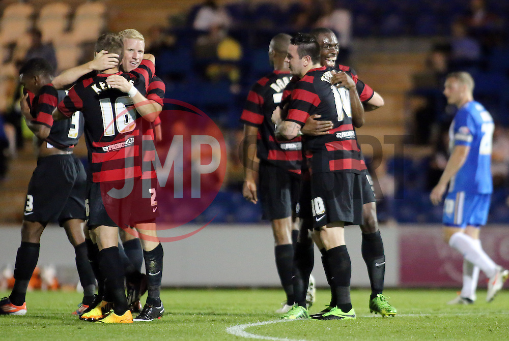 Peterborough United's Lee Tomlin celebrates scoring the fifth goal with team-mates  - Photo mandatory by-line: Joe Dent/JMP - Tel: Mobile: 07966 386802 06/08/2013 - SPORT - FOOTBALL - Weston Homes Community Stadium - Colchester -  Colchester United V Peterborough United - Capital One Cup - First Round