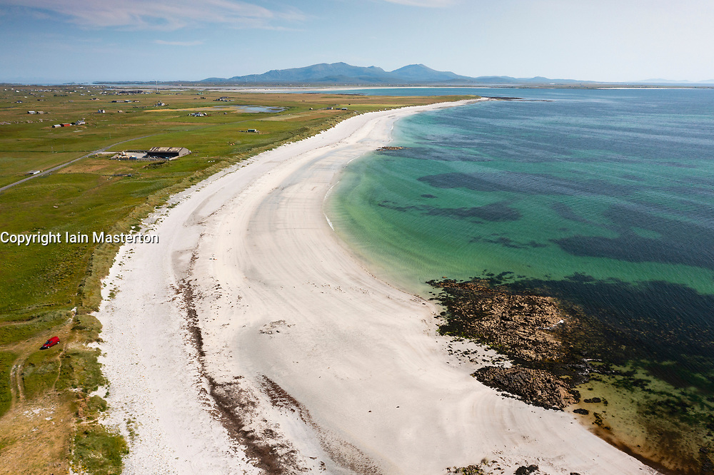 Aerial view from drone of white sands on beach on west coast of island of Benbecula looking south to South Uist, Outer Hebrides, Scotland, UK