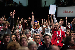 © Licensed to London News Pictures . 23/09/2019. Brighton, UK. A delegate wearing an EU beret raises her hand to speak during floor debates on motions on Labour's position on Brexit , during the third day of the 2019 Labour Party Conference at the Brighton Centre . Photo credit: Joel Goodman/LNP