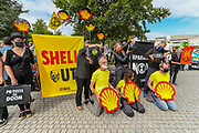 Activists spilt oil on the heads of other activists during an Extinction Rebellion performative protest in Jubilee Gardens, outside Shell Headquarters in Central London, on Tuesday, Sept 8, 2020. Protestors are seeking to step up pressure on Shell and demand an end on fossil fuel extraction as well as ecocide. Environmental nonviolent activists group Extinction Rebellion enters its 8th day of continuous ten days protests to disrupt political institutions throughout peaceful actions swarming central London into a standoff, demanding that central government obeys and delivers Climate Emergency bill. (VXP Photo/ Vudi Xhymshiti)