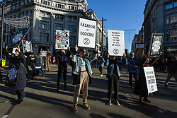 © Licensed to London News Pictures. 29/11/2019. LONDON, UK.  Members of Extinction Rebellion stage a protest at Oxford Circus on Black Friday.  Activists are protesting against throwaway fashion and excessive consumer consumption on the day when retailers are offering substantial discounts on their products.  Photo credit: Stephen Chung/LNP