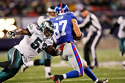 Philadelphia Eagles linebacker Moise Fokou #53 gets his arms around a New York Giant during the NFL game between the Philadelphia Eagles and the New York Giants on December 13th 2009. The Eagles won 45-38 at Giants Stadium in East Rutherford, New Jersey. (Photo By Brian Garfinkel)