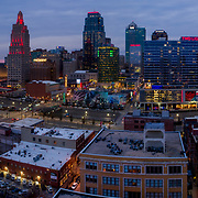 Kansas City MO skyline at dusk in early 2020 from above 20th and Main Streets with foreground view of City Club Apartments construction progress.