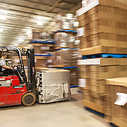 Forklift operator moving boxes in a distribution warehouse.<br /> Agency: Palmer Marketing<br /> Art Direction: Brett Gilmour<br /> Photography: Brett Gilmour