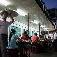 Restaurant specializing in bánh xèo in Ho Chi Minh City, also known as Saigon, Vietnam. Bánh xèo is a crisp rice-flour crêpe filled with pork, shrimp, and bean sprouts and eaten with fresh herbs.