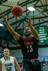 BLOOMINGTON, IL - November 12: Nigel Ferrell rebounds his own shot twice putting in the 3rd attempt during a college basketball game between the IWU Titans  and the Blackburn Beavers on November 12 2019 at Shirk Center in Bloomington, IL. (Photo by Alan Look)