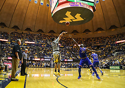 Jan 15, 2018; Morgantown, WV, USA; West Virginia Mountaineers forward Esa Ahmad (23) shoots a three pointer during the second half against the Kansas Jayhawks at WVU Coliseum. Mandatory Credit: Ben Queen-USA TODAY Sports