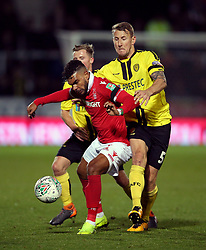 Nottingham Forest's El Arbi Soudani (left) and Burton Albion's Kyle McFadzean battle for the ball during the Carabao Cup, Fourth Round match at the Pirelli Stadium, Burton.